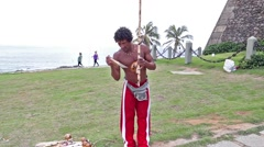 Capoeira artist playing Berimbau in Barra Lighthouse in Salvador, Brazil Stock Footage