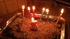 5 years old birthday cake with candles - stock footage