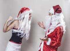 Joking girl against santa claus Stock Photos