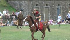 Roman re-enactors perform with horses in Dover Castle, Kent, UK. Stock Footage