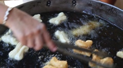 Thai food cooking in boiling oil Stock Footage