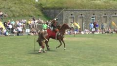 Roman re-enactors perform with horses in Dover Castle, Kent, UK. - stock footage