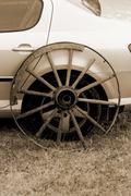 old wagon wheel addition on new cars - stock photo