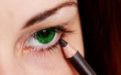 pretty lady wearing makeup for eyes - stock photo