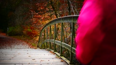 Lady Woman in red Jacket jogging running in park Autumn season Arkistovideo