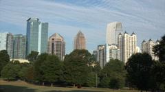 Atlanta skyline over trees from piedmont park, usa Stock Footage