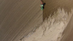 Aerial view of tractor plowing a field Stock Footage