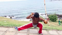 Capoeira artist performs on Barra Lighthouse in Salvador, Brazil Stock Footage