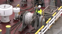 Deckhand preparing ropes on a passenger car ferry for arrival at a port. Stock Footage