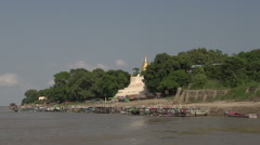 Boating on the Aye Yarwaddy river, view on golden pagoda Stock Footage