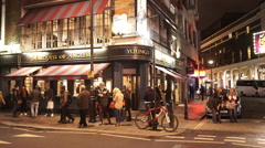 British pub at night typical London street view - stock footage