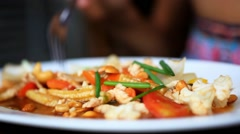 Time lapse speed up. Close up of woman hand eats stir fried chicken, vegetables Stock Footage