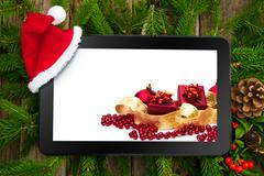 Tablet pc with christmas decoration Stock Photos