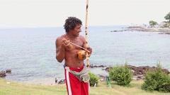 Capoeira artist playing Berimbau in Salvador, Brazil Stock Footage