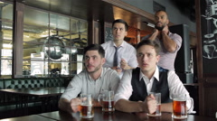 Four friends businessmen drink beer and rejoice - stock footage