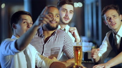Men shout and rejoice in meeting and drink beer - stock footage