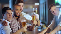 Activities of real men in a bar with beer - stock footage
