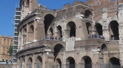 Pan right Great Colosseum forum tourist people visit Rome landmark day old arena Stock Footage