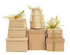 Stock Photo of gift boxes tied with natural raffia of different colors