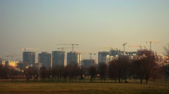 Construction of multi-storey buildings. A large number of construction cranes. T Stock Footage