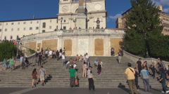 Stock Video Footage of Piazza di Spagna Spanish Steps Rome tourist climb stairway squareTrinita Monti