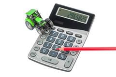 Tractor, red pencil and calculator Stock Photos
