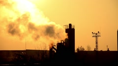 Emissions to the atmosphere. industrial pipes. View of the sun through the thick Stock Footage