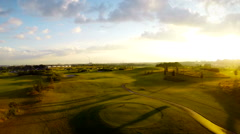 Sunset at golf course, aerial footage Stock Footage