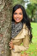 young woman with tree - stock photo