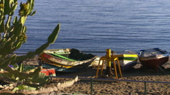 Old fishing boats on the beach Stock Footage