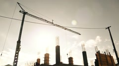 Crane Above Construction Site Long Shot Reduced Color Silhouette Workers Stock Footage