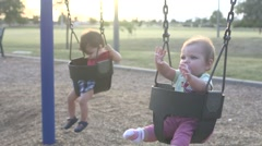 baby girl on swing, baby boy in view 02 - stock footage
