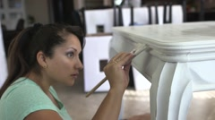 latin woman painting table 03 - stock footage