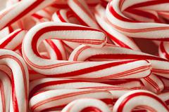 Red and white mini candy canes Stock Photos