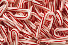 red and white mini candy canes - stock photo