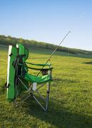 Chair fisherman and a fishing rod. - stock photo