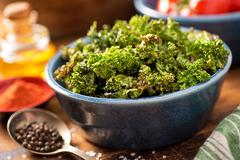 Baked kale chips Stock Photos