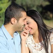 Arab casual couple flirting laughing happy in a park Stock Photos