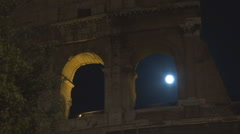 Closeup Great Colosseum forum wall silhouette moon light night darkness Rome  Stock Footage