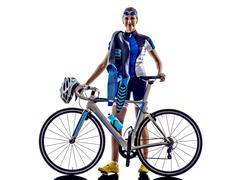 Woman triathlon ironman athlete cyclist cycling Kuvituskuvat