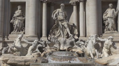 Trevi Fountain Rome landmark sunny day Neptune statue iconic baroque facade pool Stock Footage