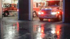 Fire Truck  and Ambulance Pull Out Of Station At Dusk On Rainy Day Stock Footage