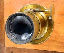 Lens of antique photographic folding Stock Photos