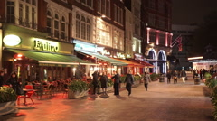 Stock Video Footage of Small restaurants and bars at London Leicester Square