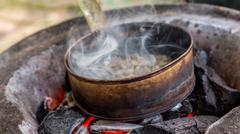 Roasting coffee on charcoal - stock photo