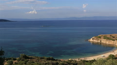 Wild sandy beach in the beautiful bay of Aegean Sea. Stock Footage