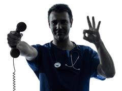doctor man silhouette holding phone gesture - stock photo