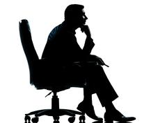 One business man sitting in armchair silhouette Stock Photos