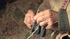 Hands of an old woman knitting sock 4k Stock Footage