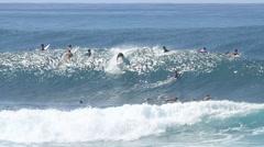 Surfer tucks into small tube Stock Footage